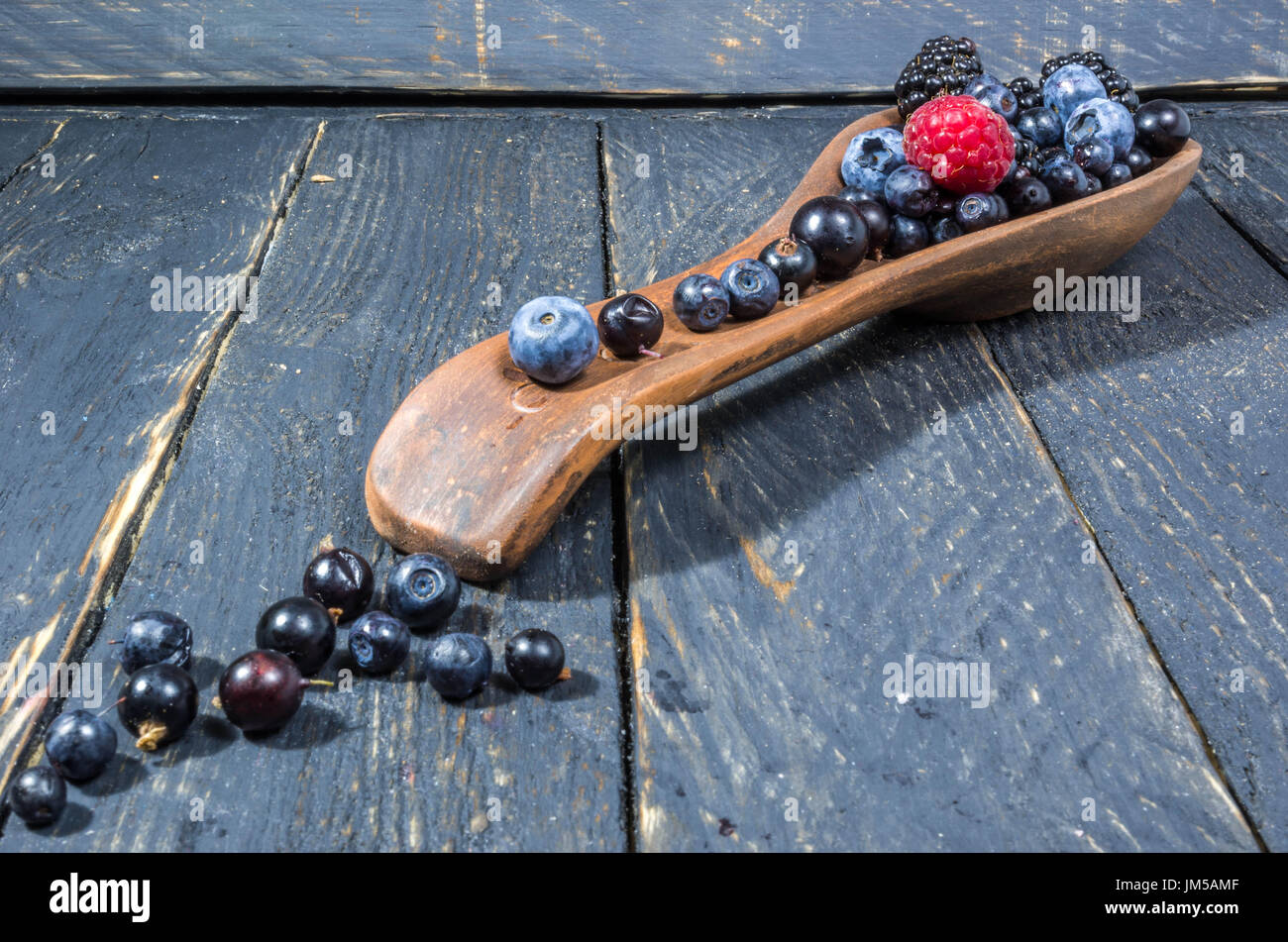 Decoration of forest berries. Diagonal foto. Perspective. The dark photo - Stock Image