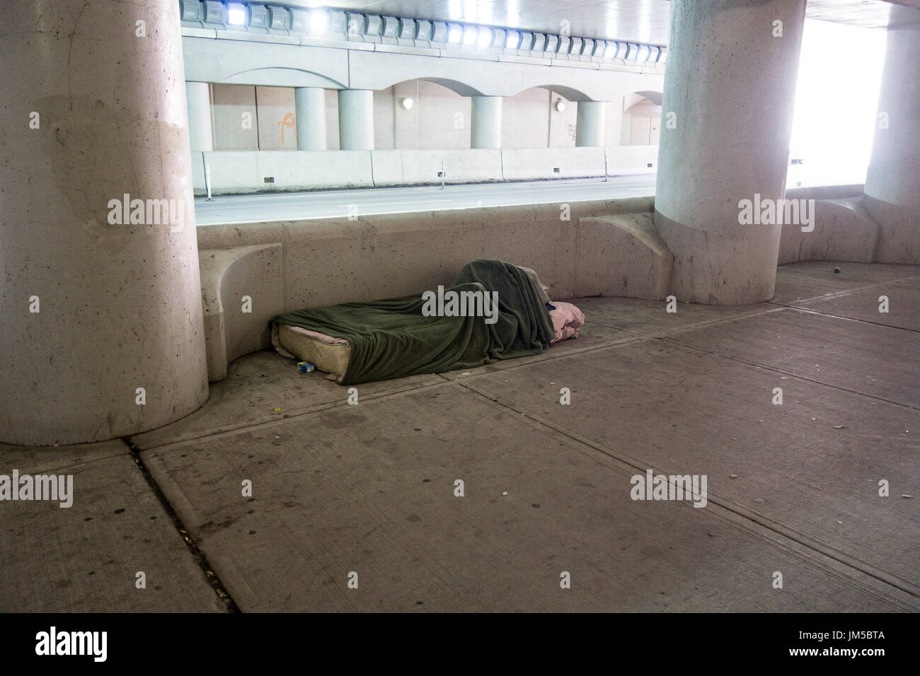 unoccupied-bed-for-homeless-person-along