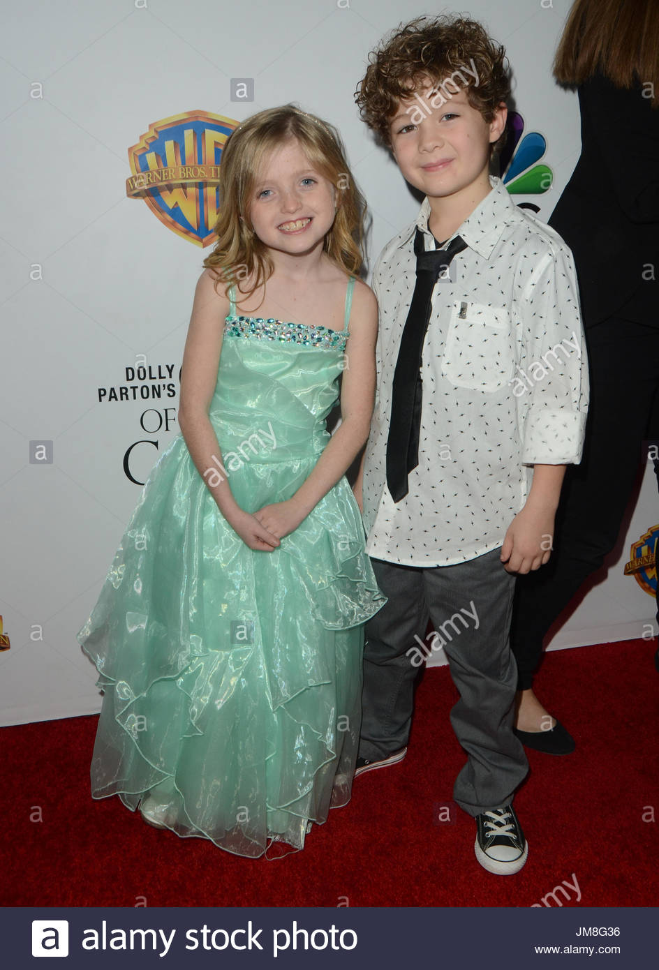 Farrah Mackenzie and Blane Crockarell. Arrivals at the Premiere Of Warner Bros. Television's 'Dolly Parton's - Stock Image