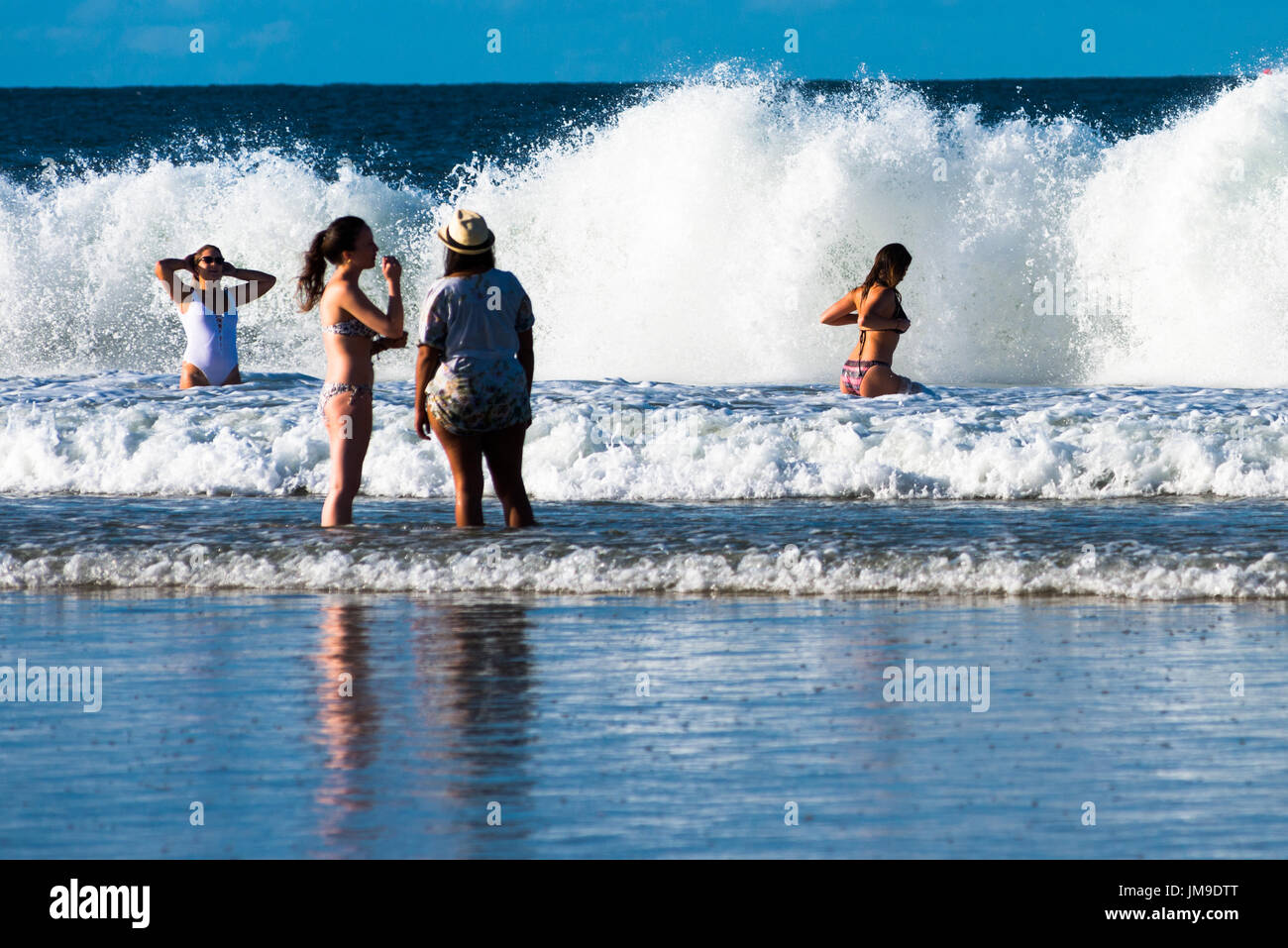 bathers-face-large-waves-at-the-wreck-of