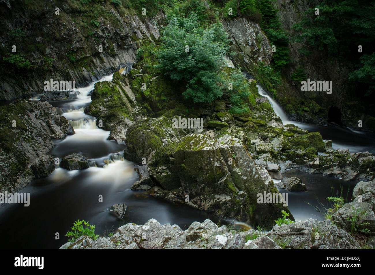 A long exposure of the beautiful Conwy Falls waterfall in Snowdonia National Park, Wales - Stock Image