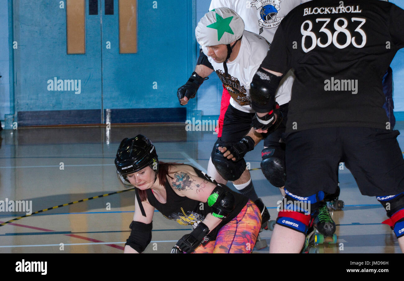 Women skater on the floor during a mixed roller derby bout - Stock Image
