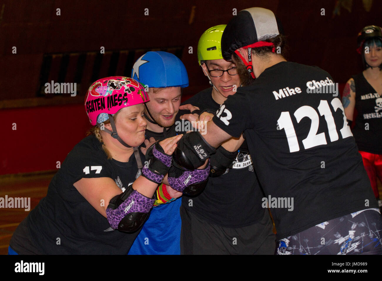 A mixed three wall block during a roller derby bout - Stock Image