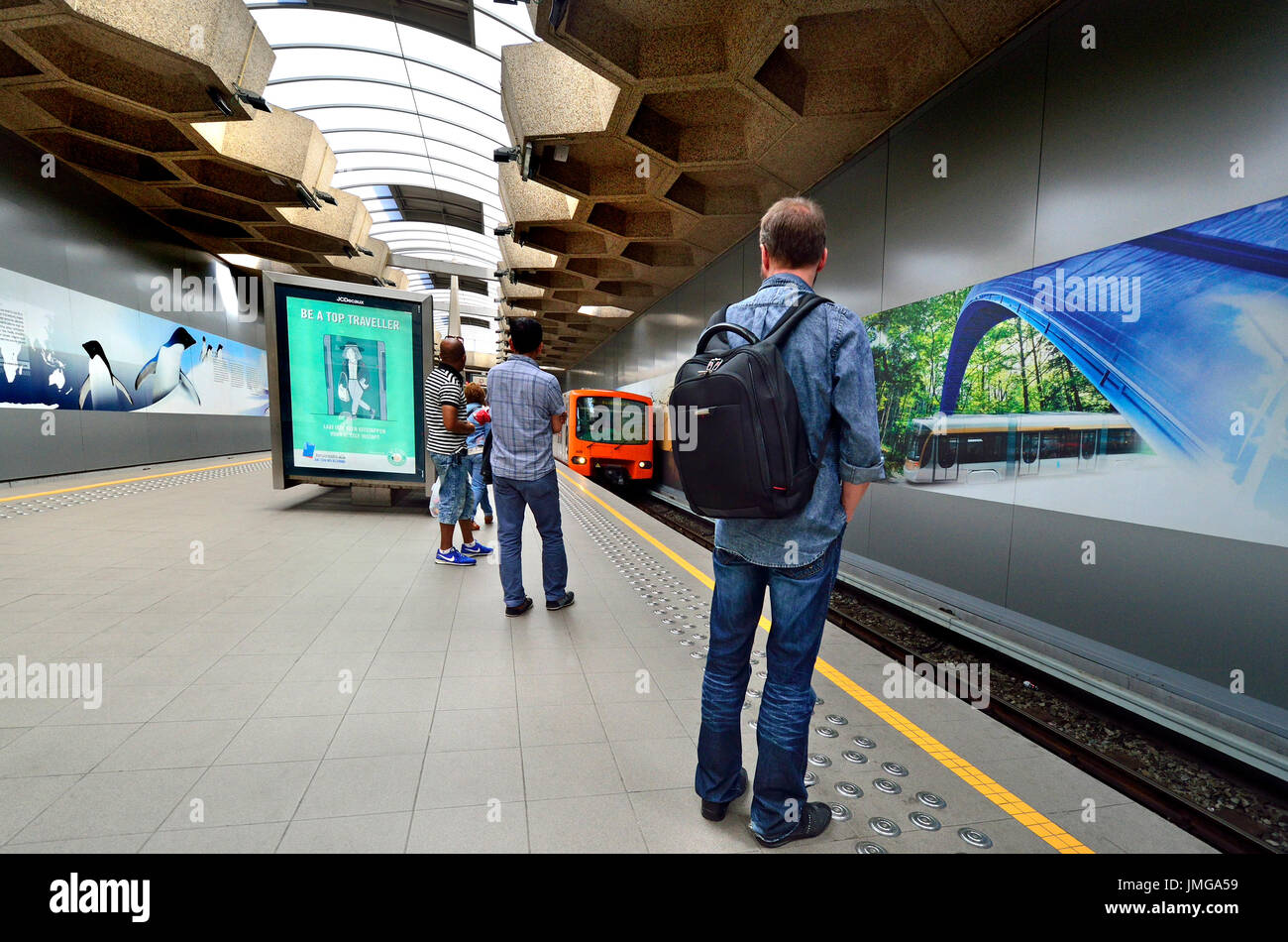 Brussels, Belgium. Belgica metro station - train arriving at the platform - Stock Image