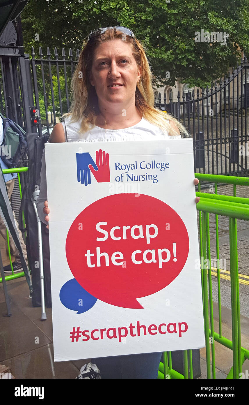 Nurse and mother-of-four Carey Johnson, who spoke at a Royal College of Nursing (RCN) rally outside Downing Street - Stock Image