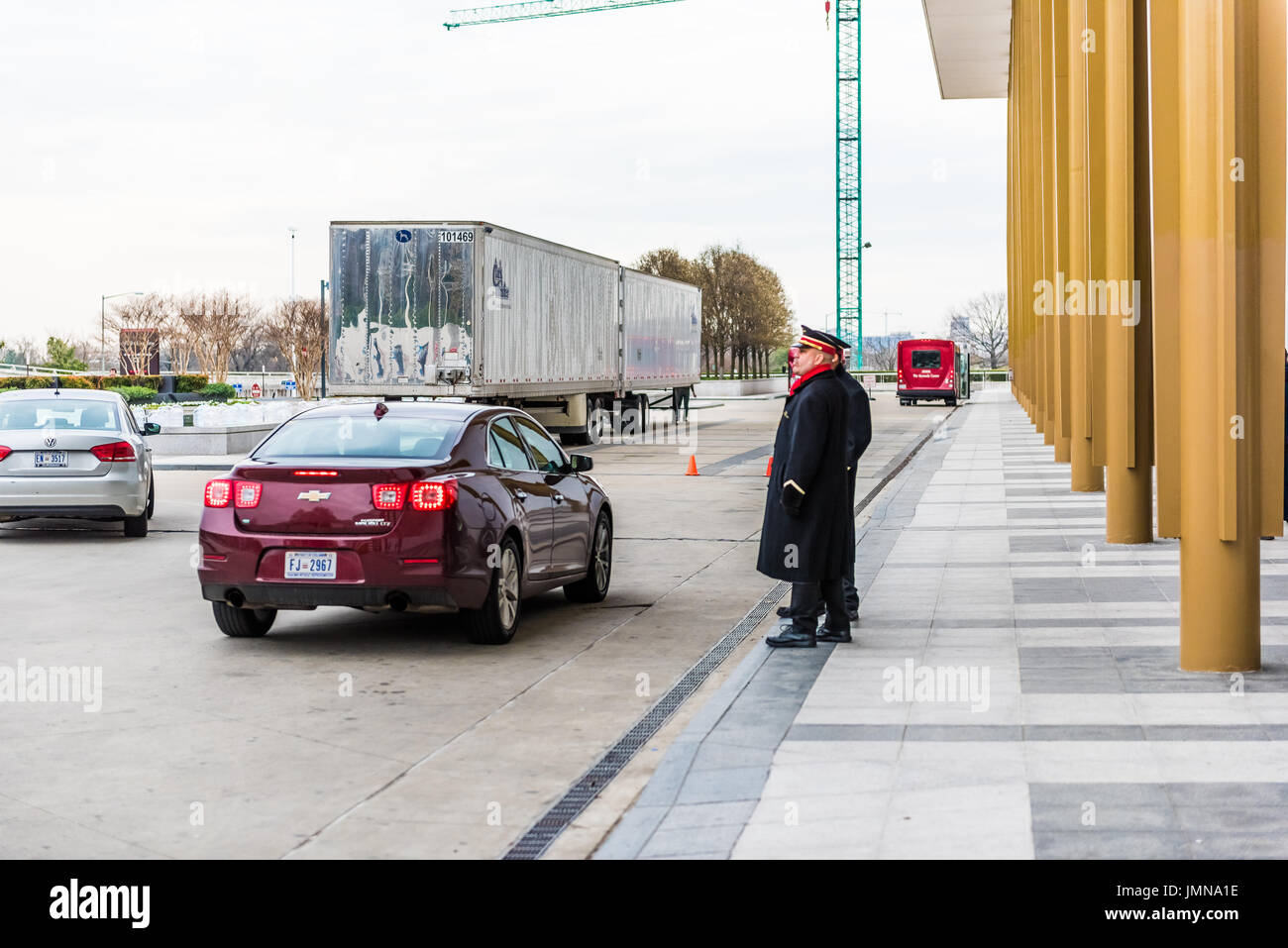 Washington DC, USA - March 20, 2017: John F. Kennedy Center entrance with cars driving up and doormen assisting - Stock Image