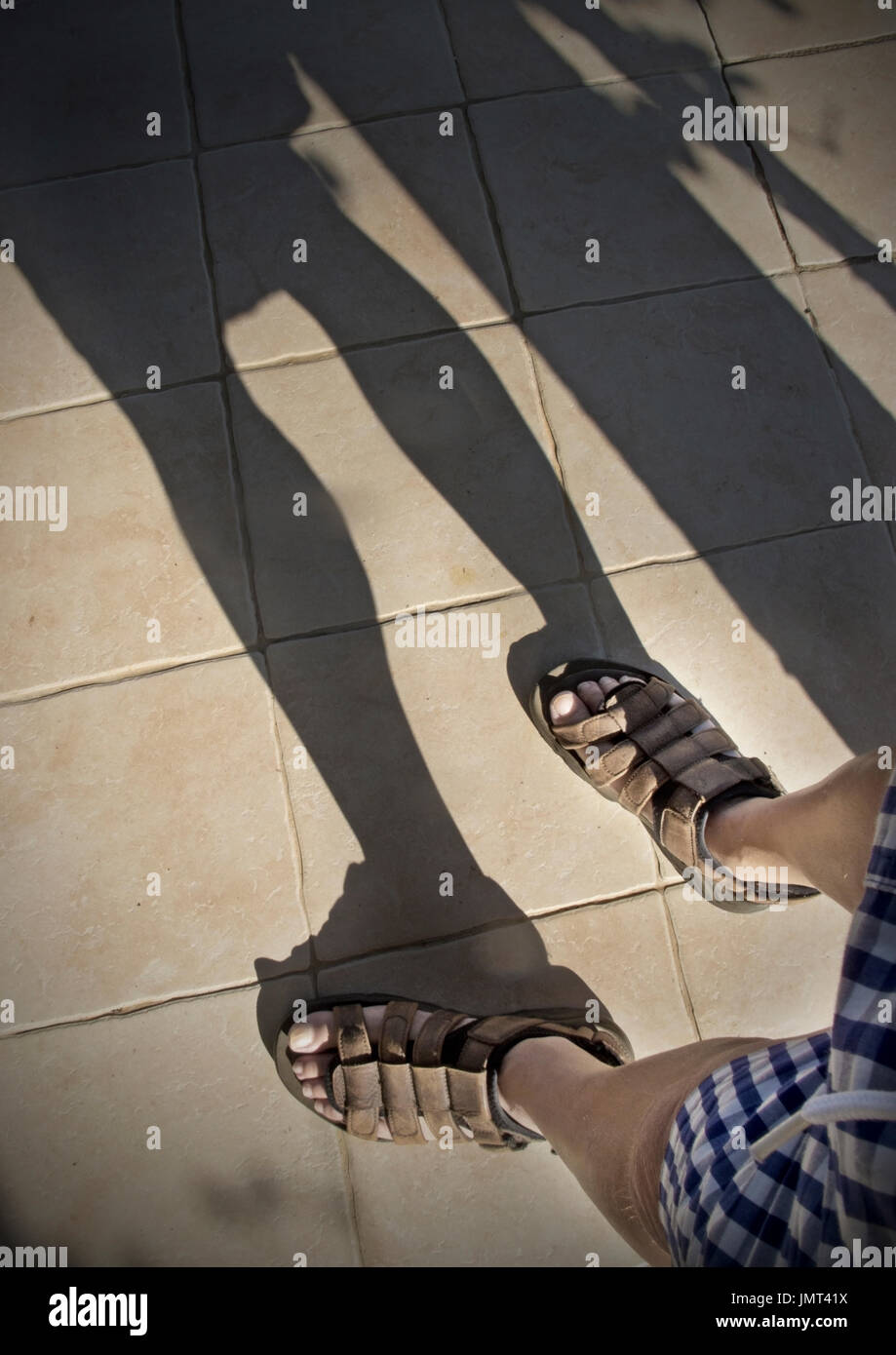man in sandals - Stock Image