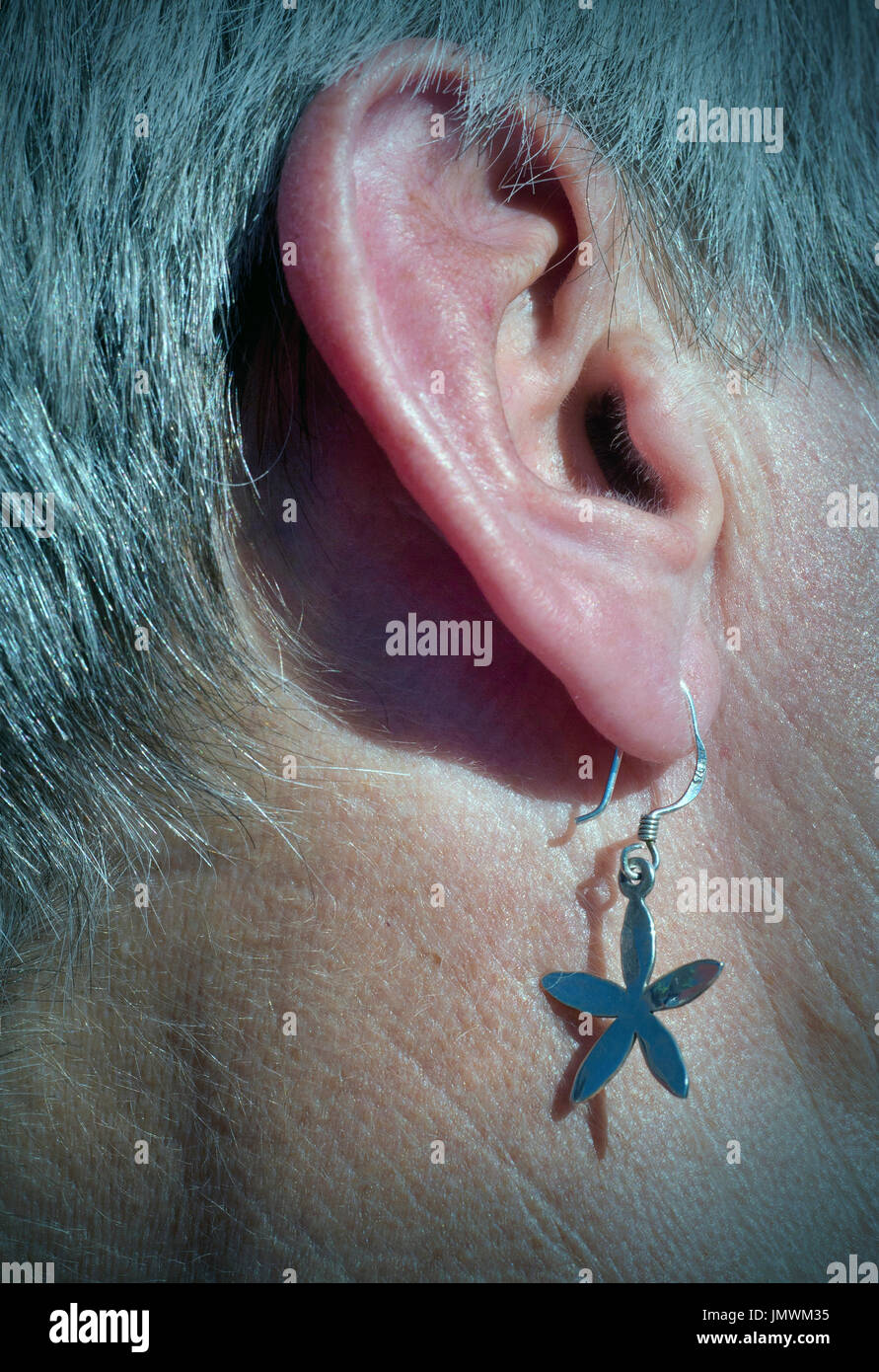 womens ear with ear ring - Stock Image