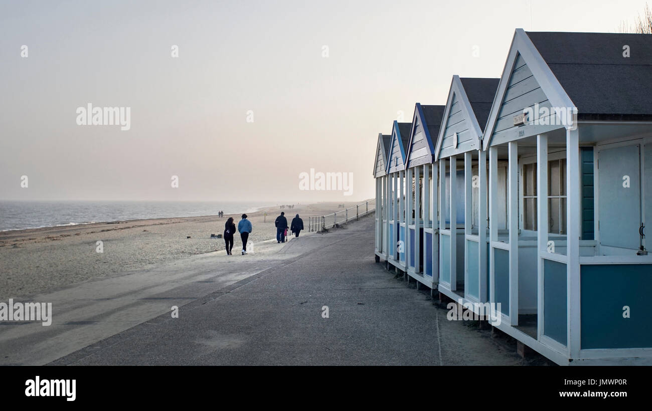 winter walkers at southwold suffolk england - Stock Image