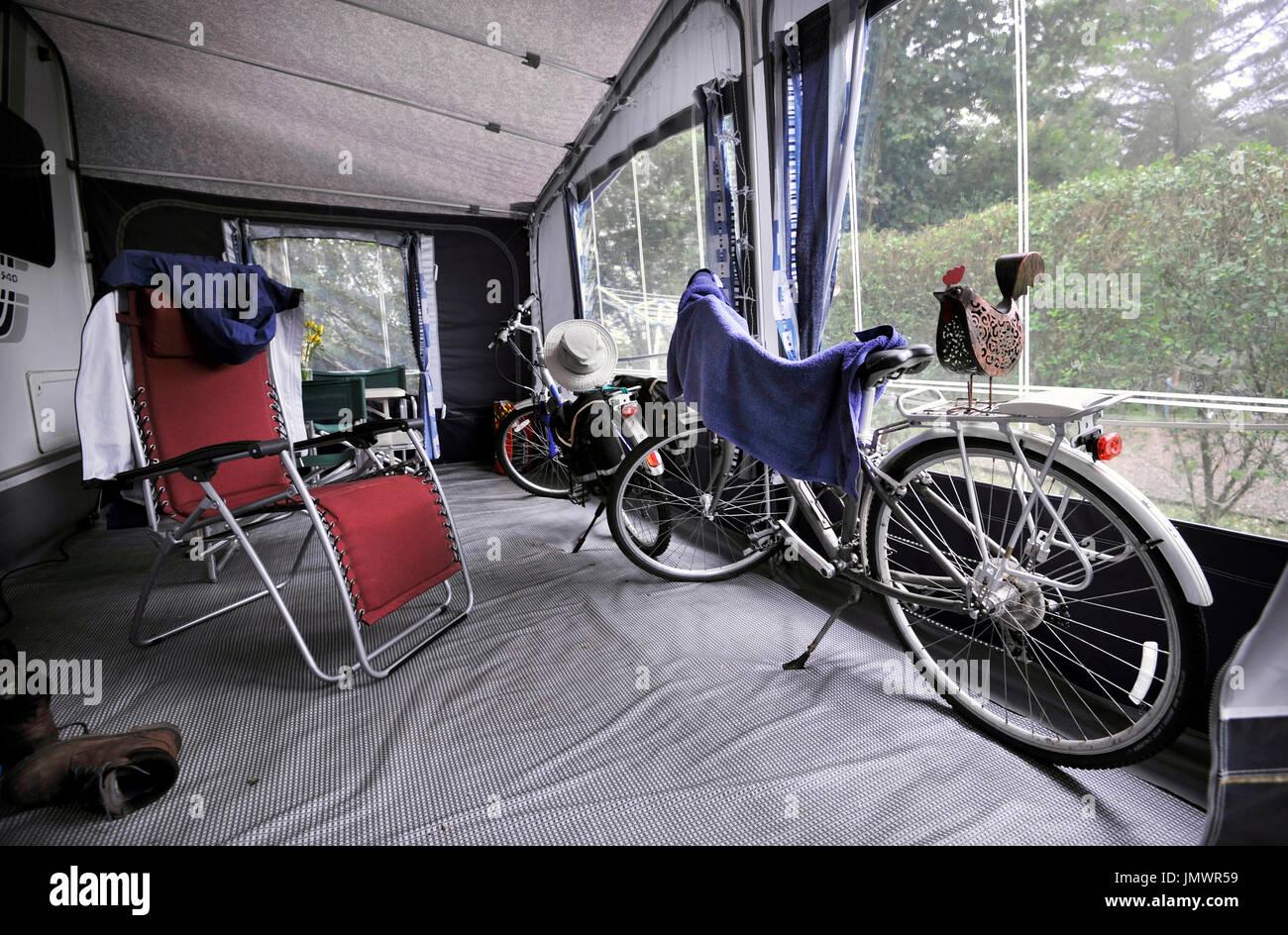 bikes stored inside caravan awning - Stock Image