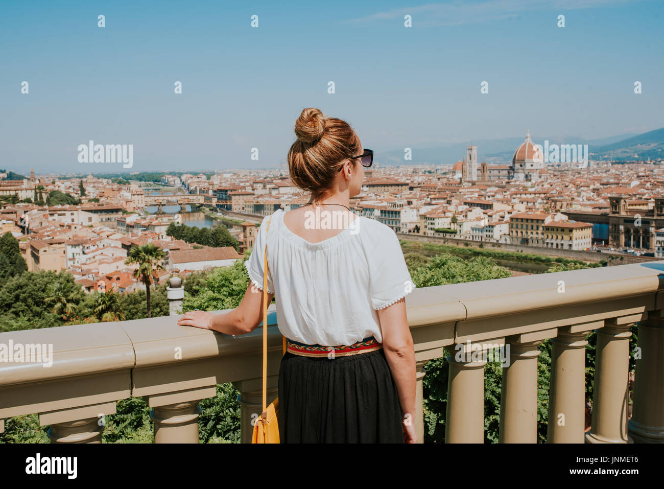 Woman looking at the city of Florence - Stock Image