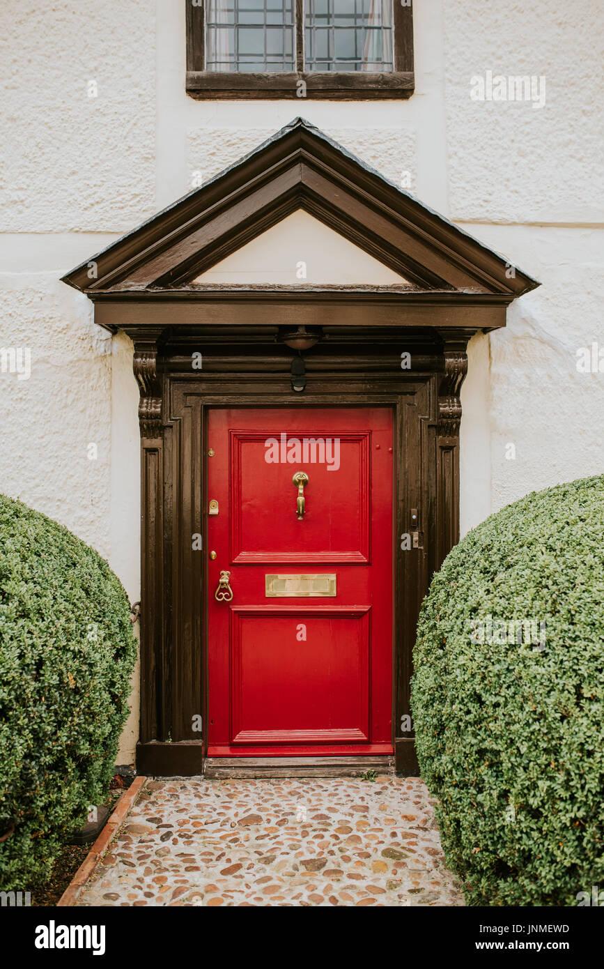 Classic red wooden door in England - Stock Image