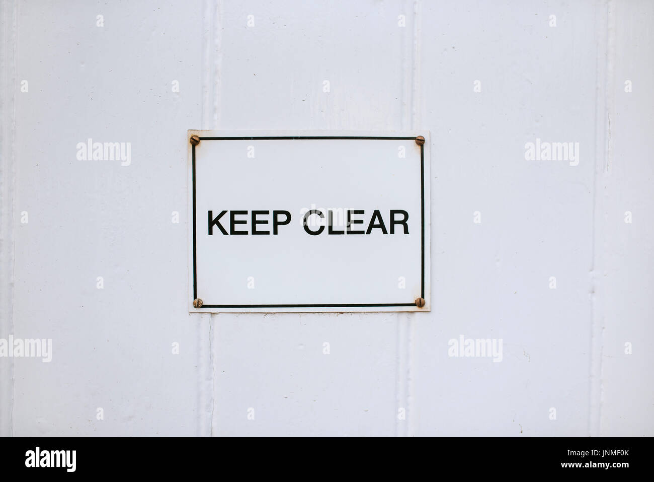 Metal keep clear sign on withe background - Stock Image