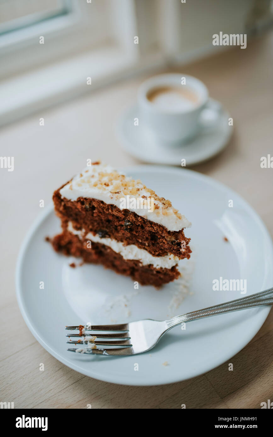Carrot cake and coffee in cafe - Stock Image