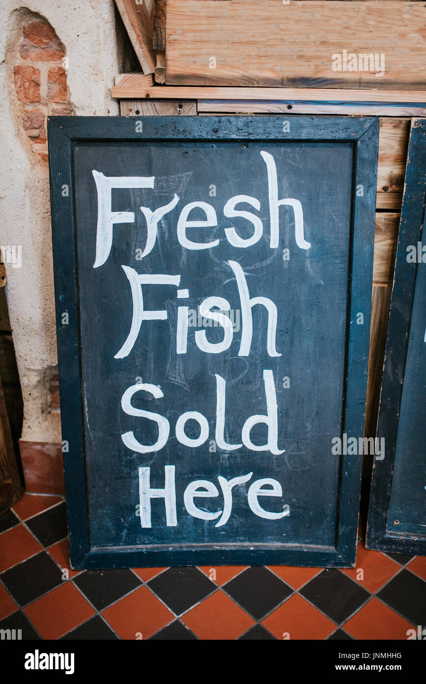 Fresh fish sold here sign - Stock Image