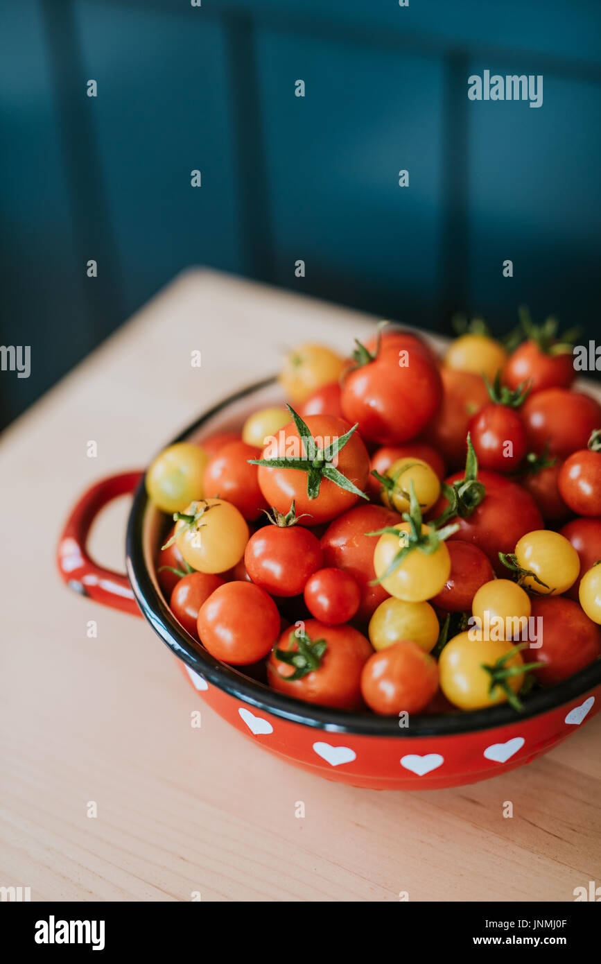 Cherry tomatoes in a bowl - Stock Image