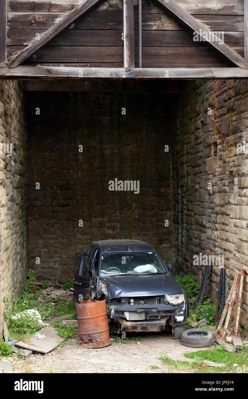Wrecked car, Sowerby Bridge, West Yorkshire - Stock Image