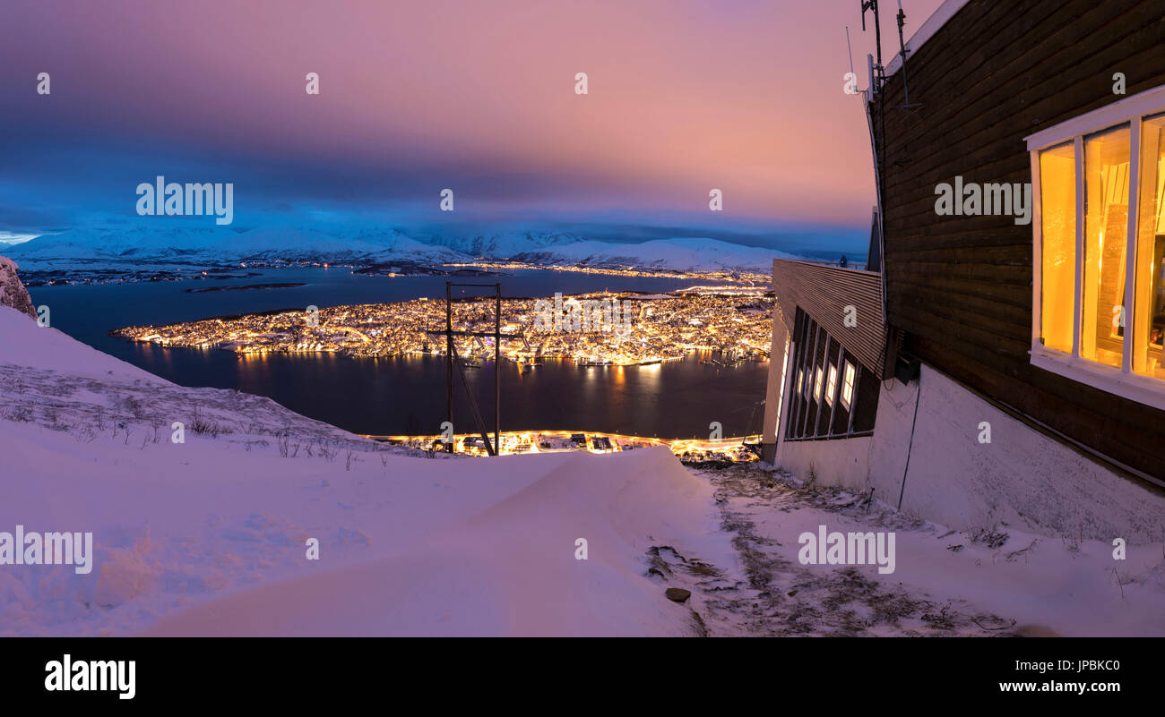 Panorama of wood chalet on mountain top reached by the Fjellheisen cable car overlooks the city of Tromsø at - Stock Image