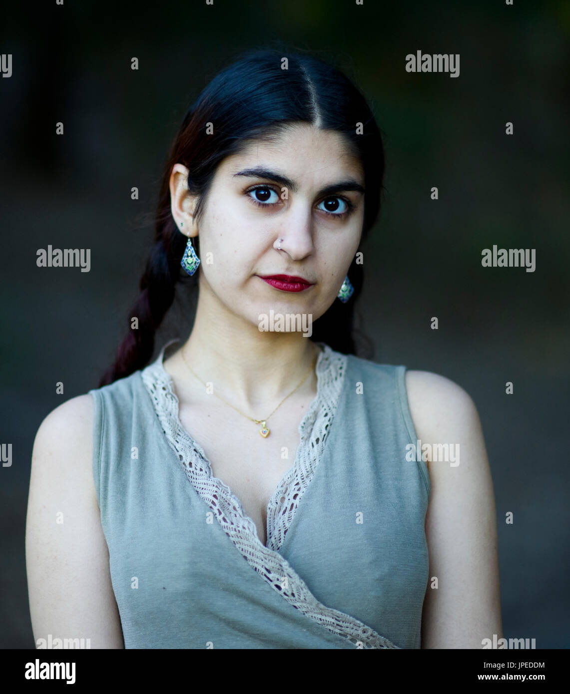 Young Persian Woman poses for photos in a Park - Stock Image