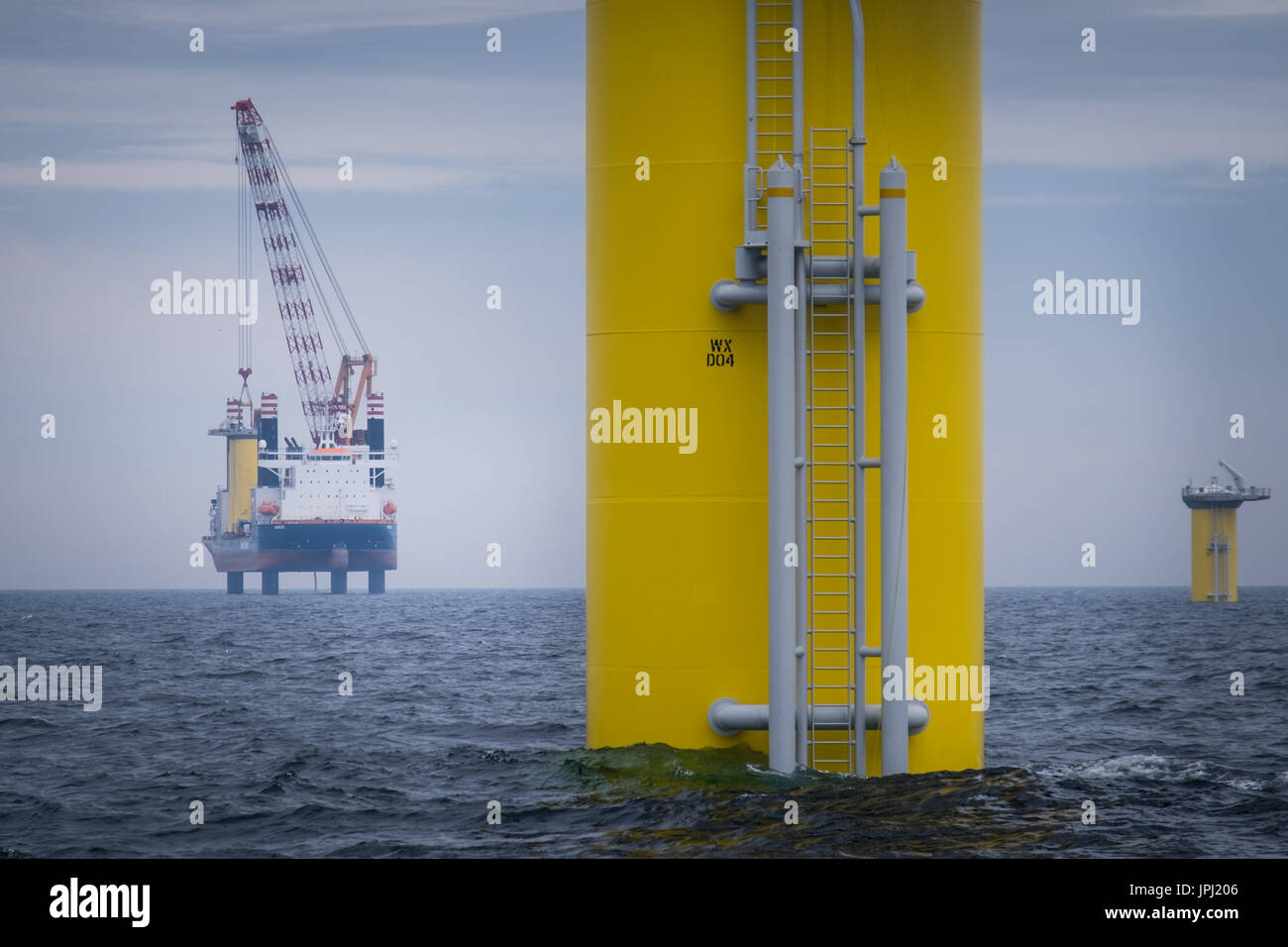 The jack-up vessel, Aeolus, installing the Transition Pieces (TP's) on the Walney Extension Offshore Wind Farm - Stock Image