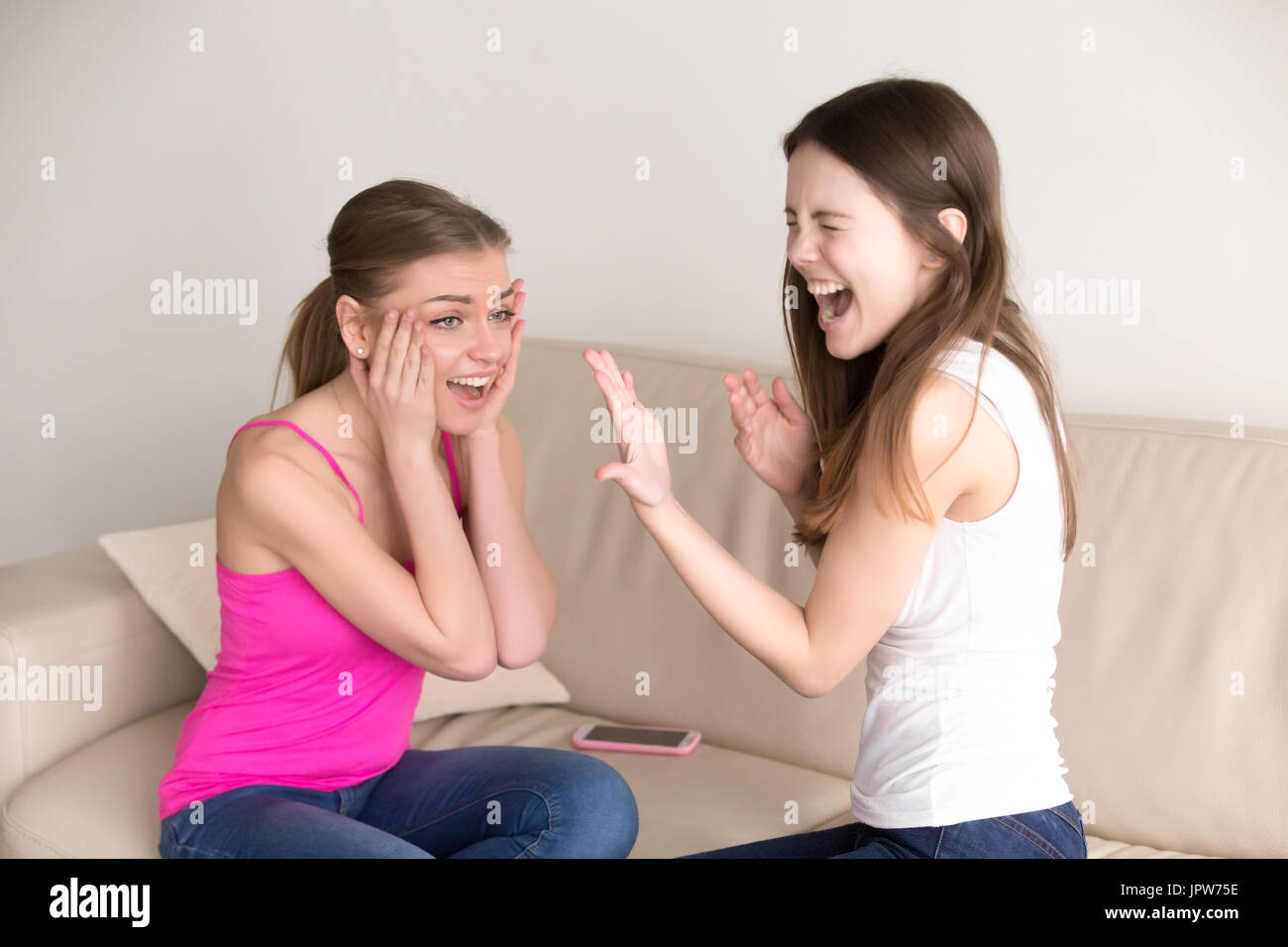 Happy young ladies celebrating wedding proposal - Stock Image