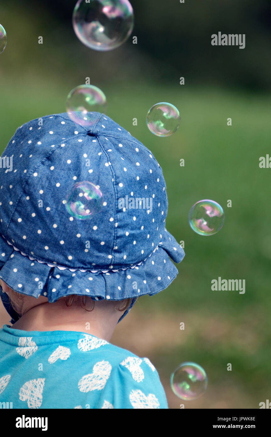 small child with bubbles from rear - Stock Image