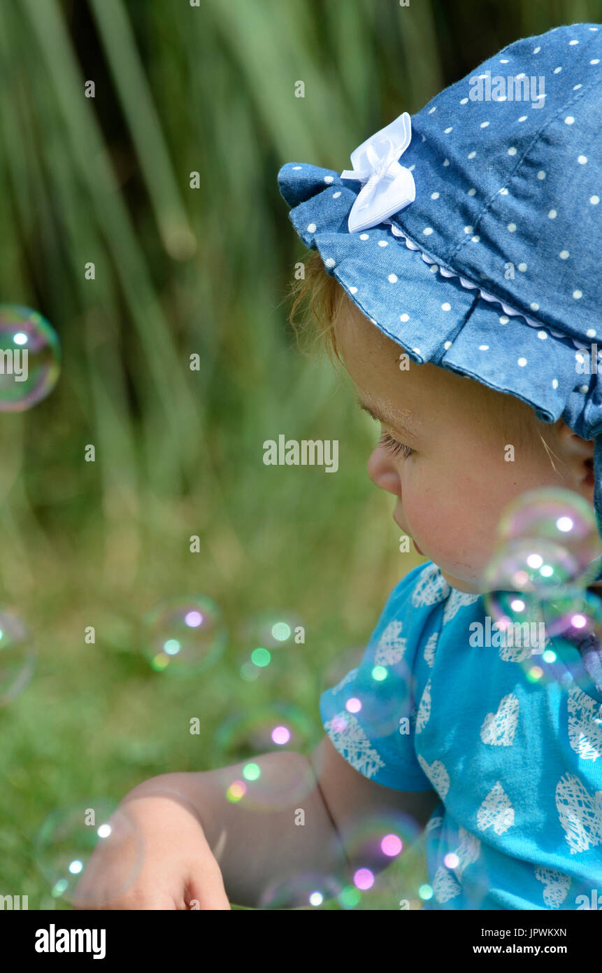child, children, toddler, hat, spotted bubbles, fun, innocence,  [WP] ''with people'' ''light - Stock Image