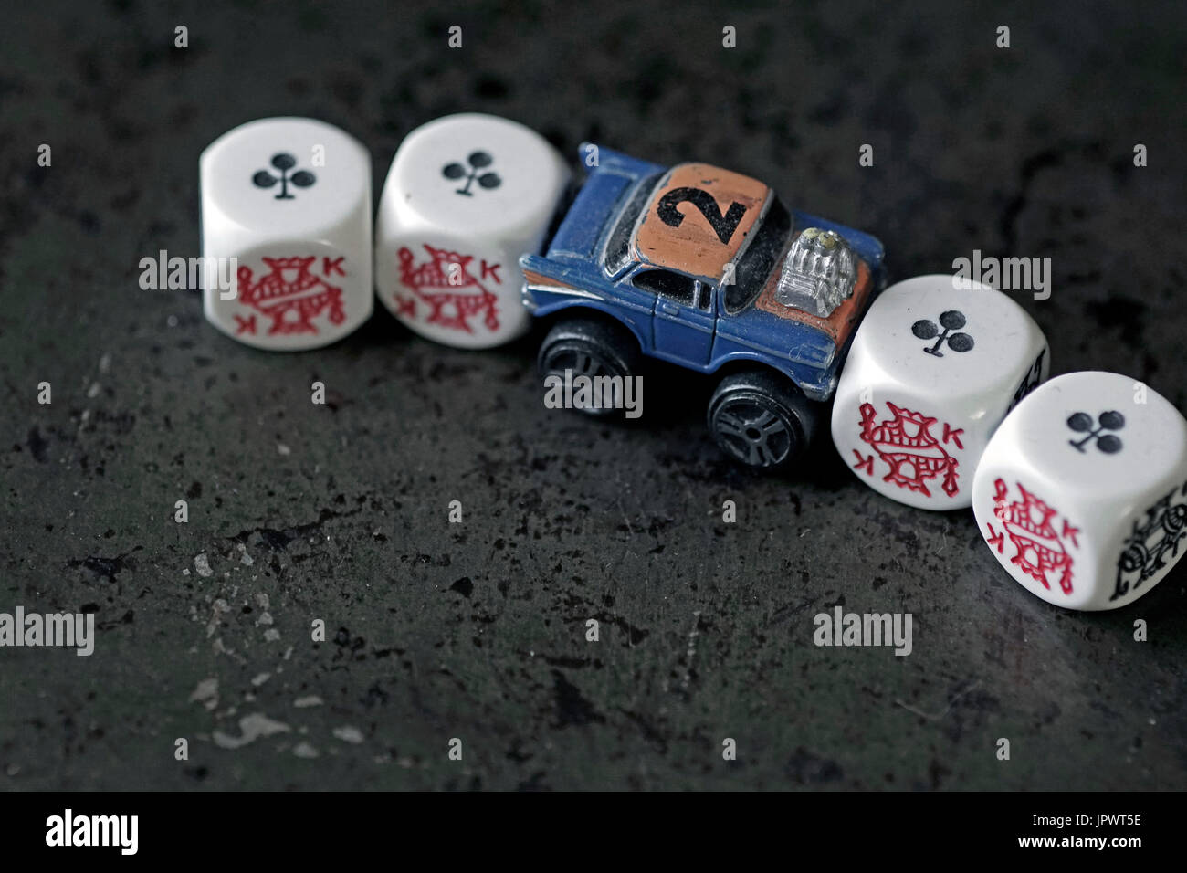 model car pushing dice out of frame - Stock Image