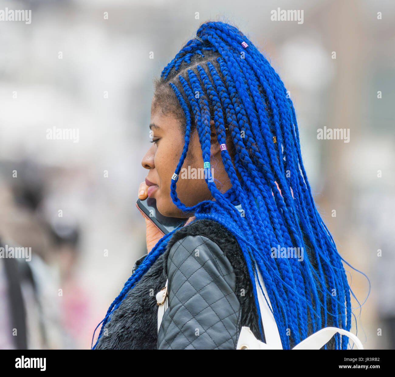 young-black-woman-with-braided-blue-hair-JR3RB2.jpg