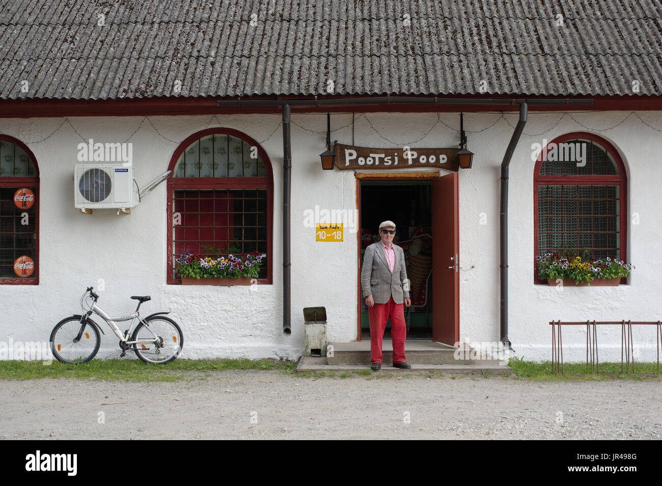 A man is standing in front of the store Pootsi. Pärnu county, Estonia, 2017 - Stock Image