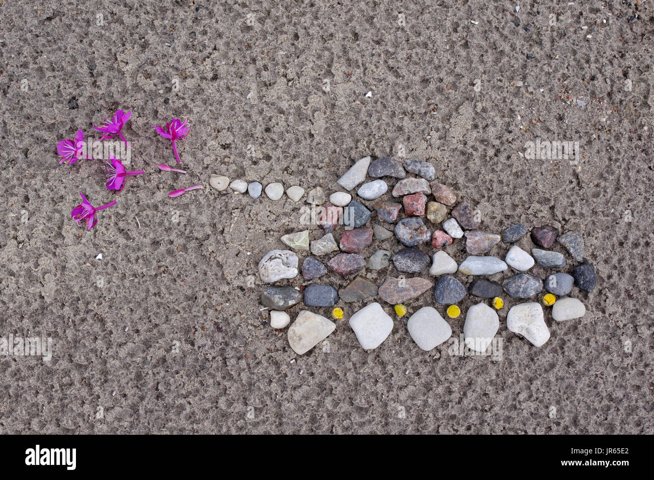 Small stones made tank that shoots the blossoms. - Stock Image