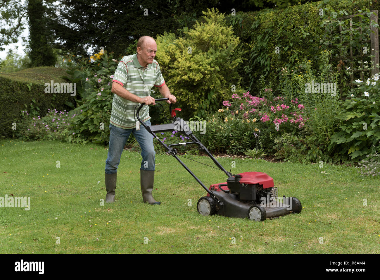 Man mowing lawn stock photos man mowing lawn stock for Lawn mower cutting grass