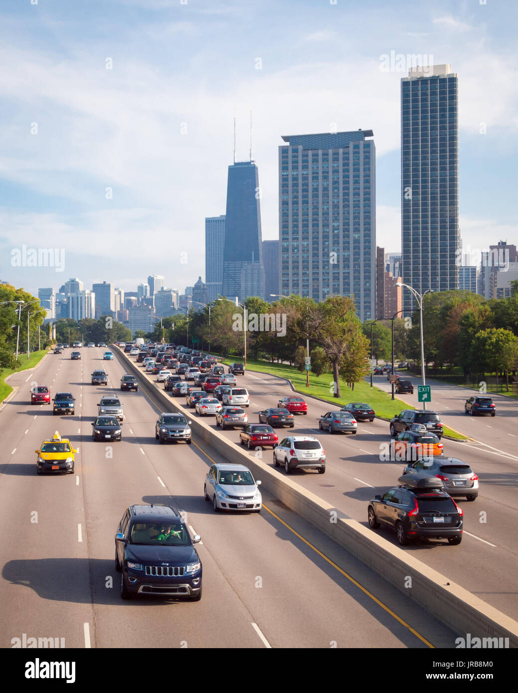 A view of the car traffic on North Lake Shore Drive and the Chicago skyline, including the John Hancock Center. - Stock Image