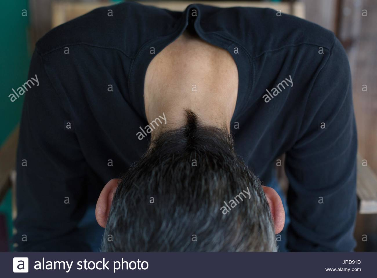 Close up of the back of a woman's head, with very short hair. - Stock Image