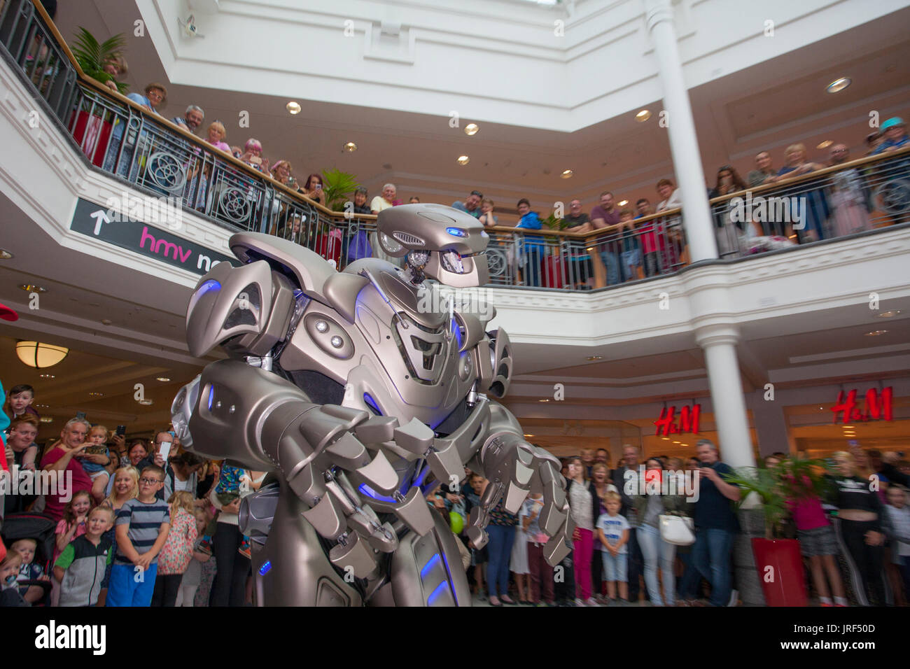 Preston, Lancashire, UK . Titan the robot, wearing an exoskeleton suit, wows the crowds at St George's Centre. - Stock Image