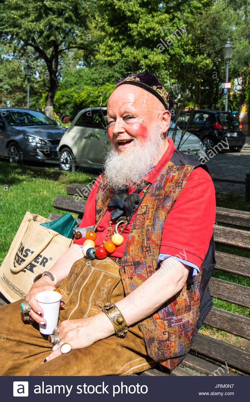 senior-man-on-city-bench-happy-senior-ma