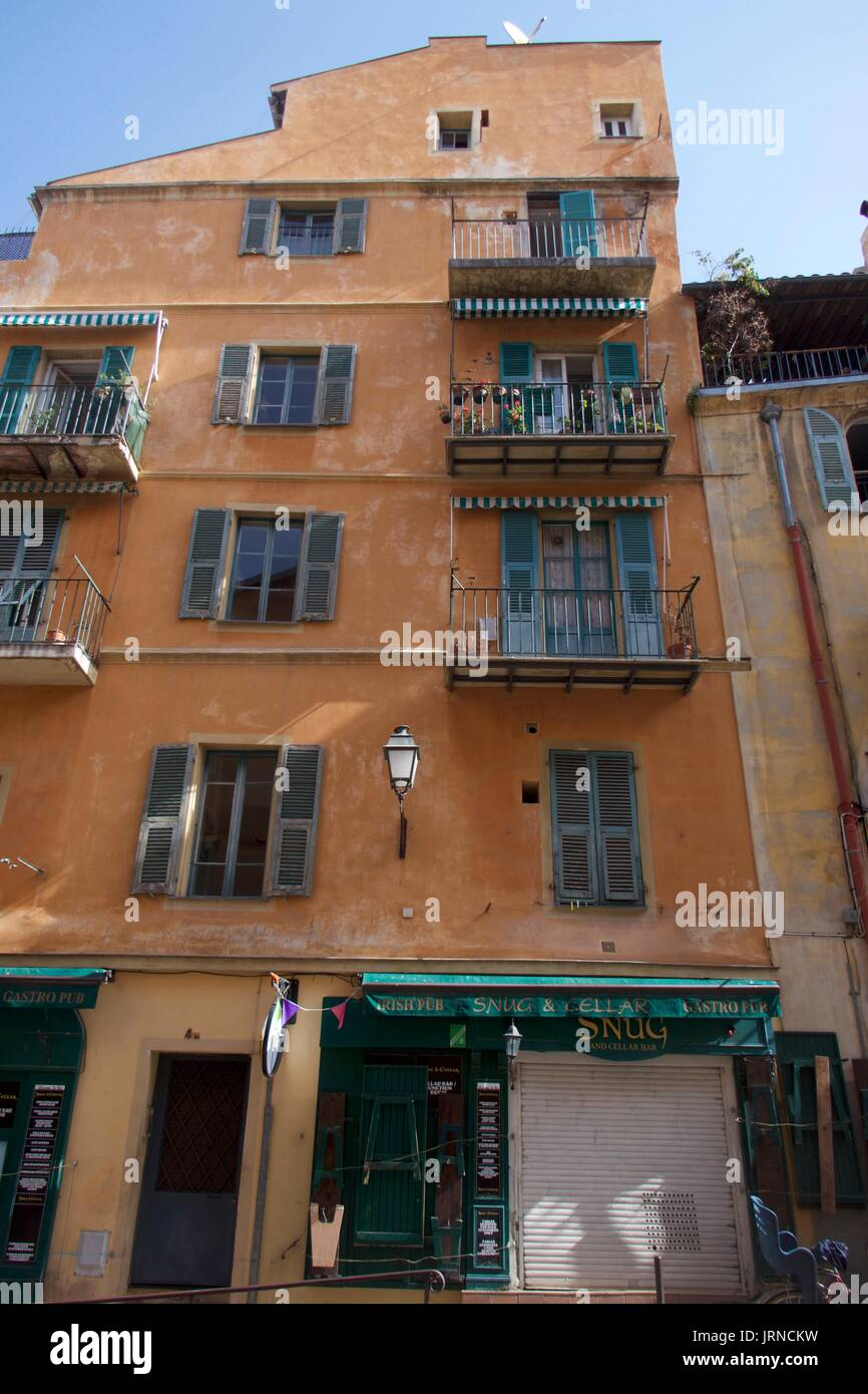 Apartment balcony shutters stock photos apartment for Apartments with shops below