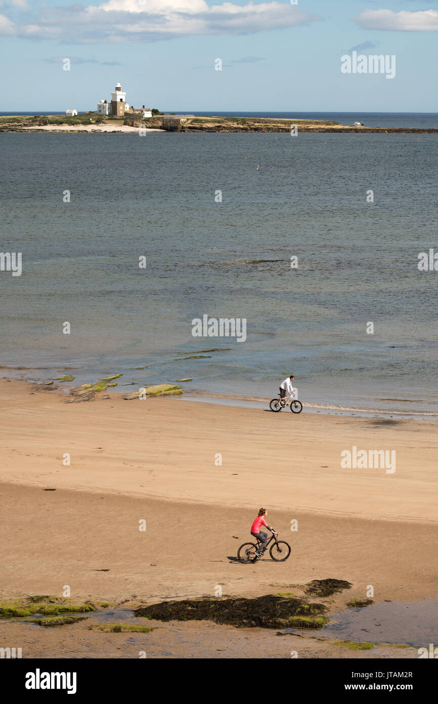 young-couple-cycling-on-the-beach-south-