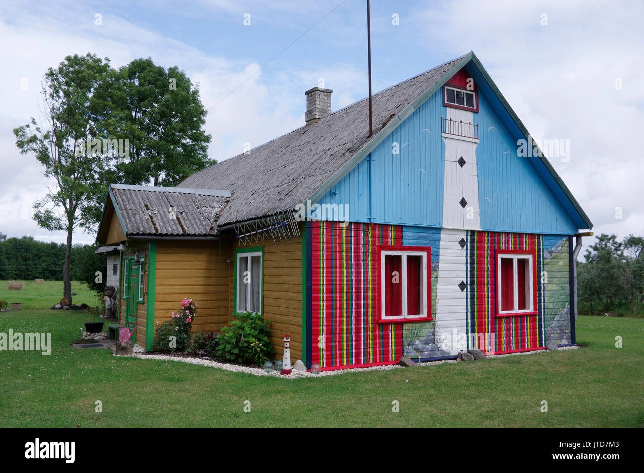 The facade of the House painted Kihnu skirt colors. Kihnu Island, Estonia 5th August 2017 - Stock Image