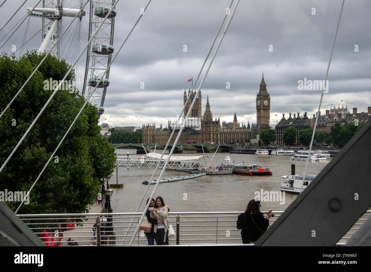 view of the London Eye, Big Ben and Westminster Abbey Houses of Parliament from a train window on one of London's - Stock Image