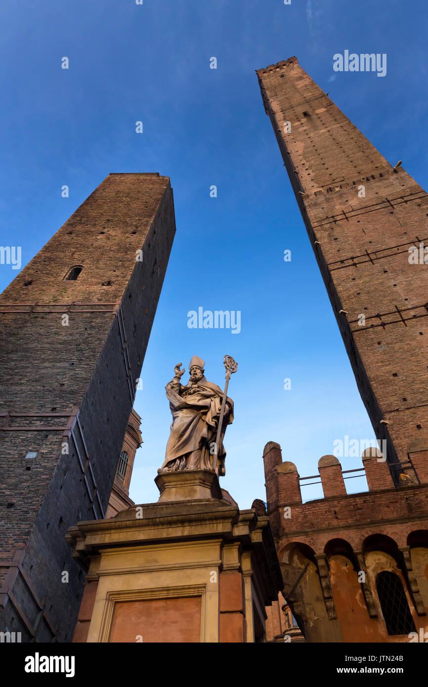 Garisenda Tower, Statue of St Petronius and Asinelli Tower, Bologna, Emilia-Romagna region, Italy - Stock Image