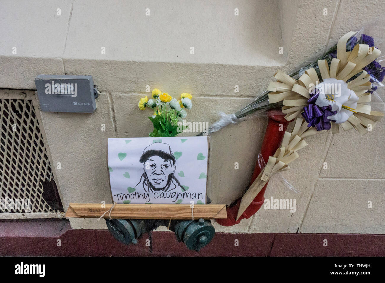 memorial tribute to black victim of hate crime include superb ink portrait of his bleak face fastened to standpipe - Stock Image