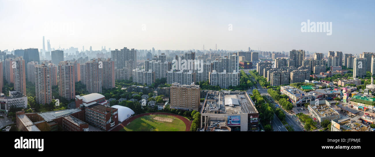 a-view-looking-down-at-the-shanghai-skyline-form-the-top-of-an-apartment-JTPMJE.jpg