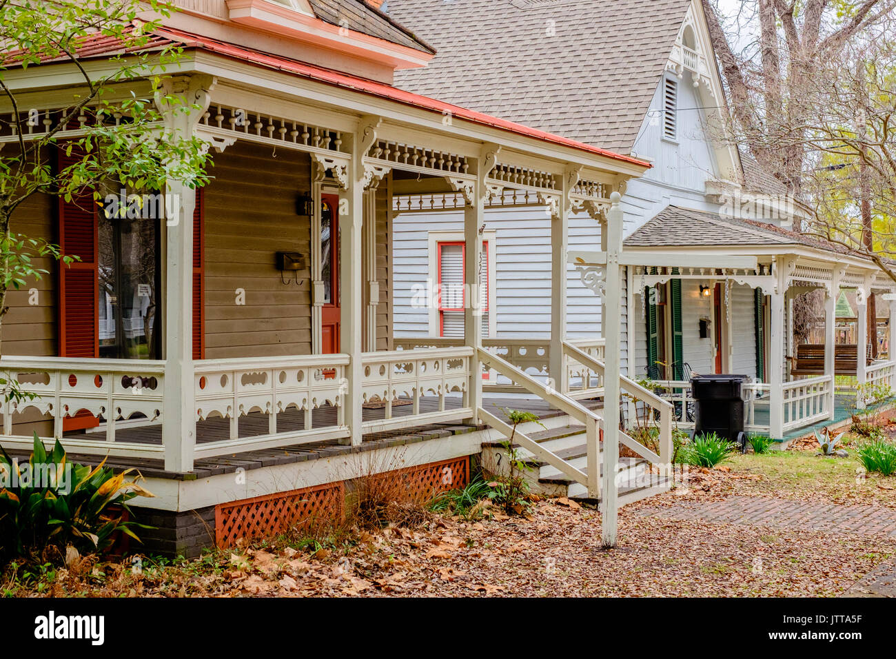 Victorian style homes along a residential street in the fall. - Stock Image