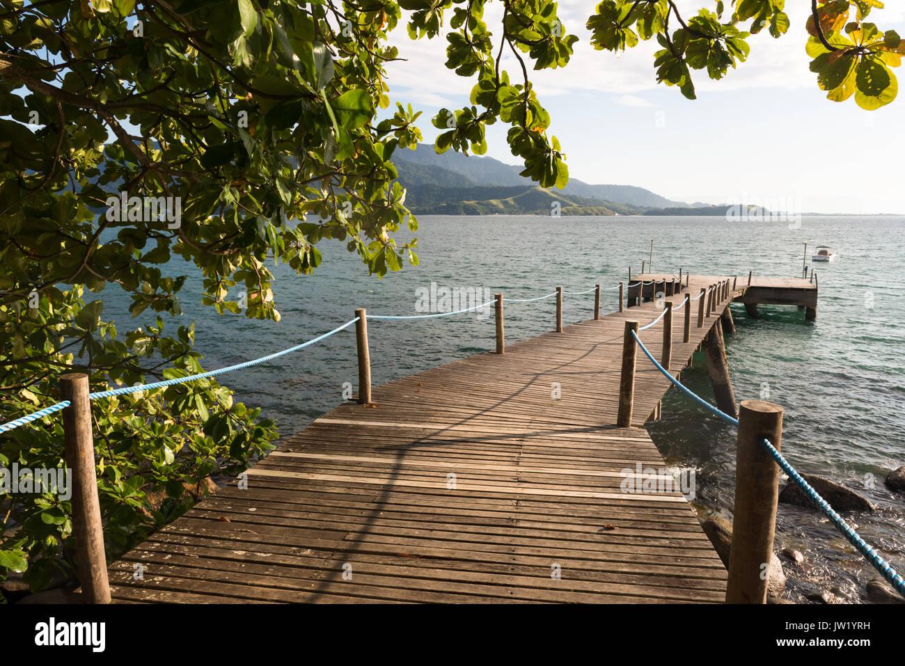 A wooden pier in Ilhabela, Brazil - Stock Image