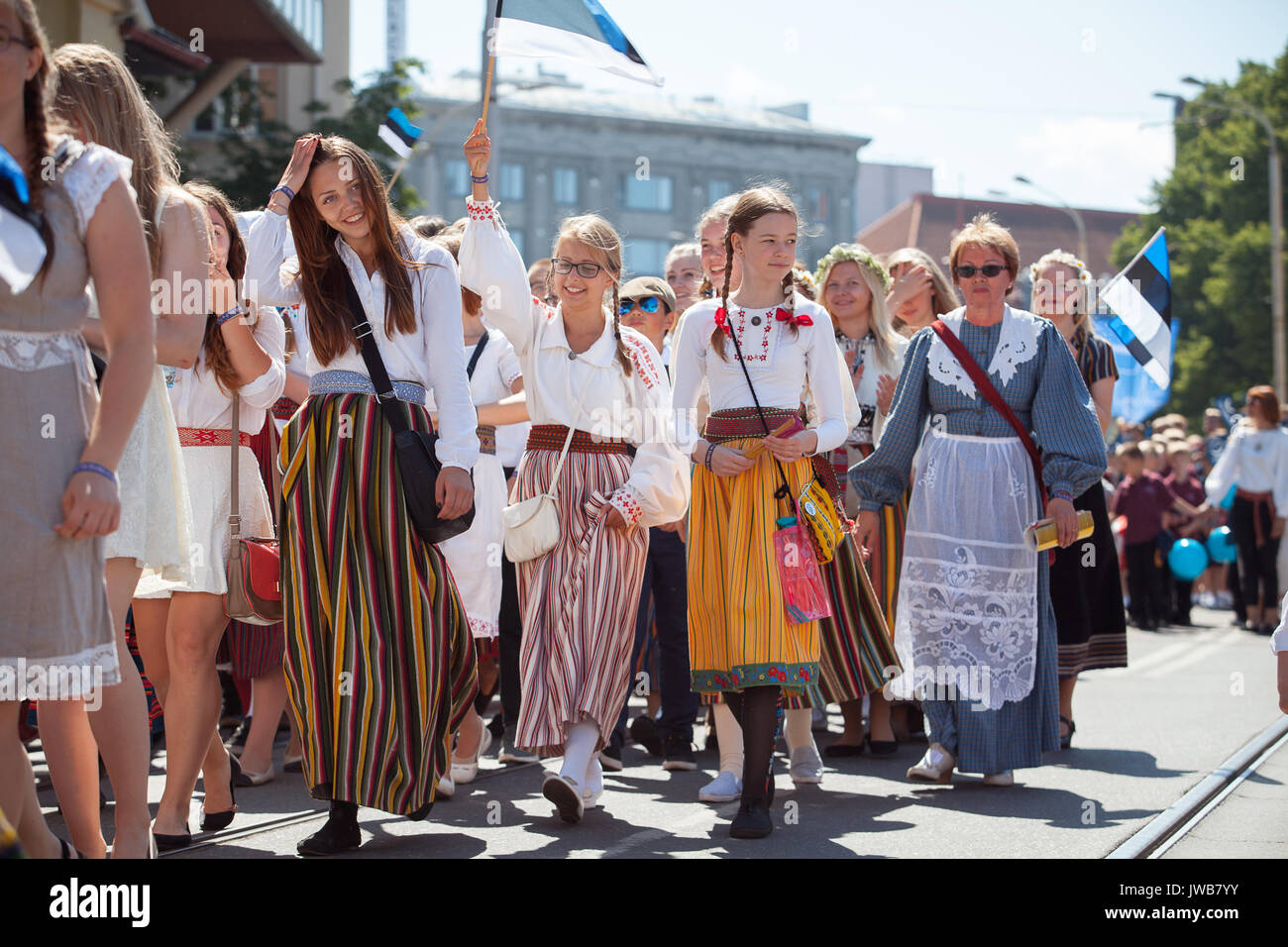 TALLINN, ESTONIA - 04 JUL 2014: People in Estonian costumes going at ceremonial procession of Estonian song and - Stock Image