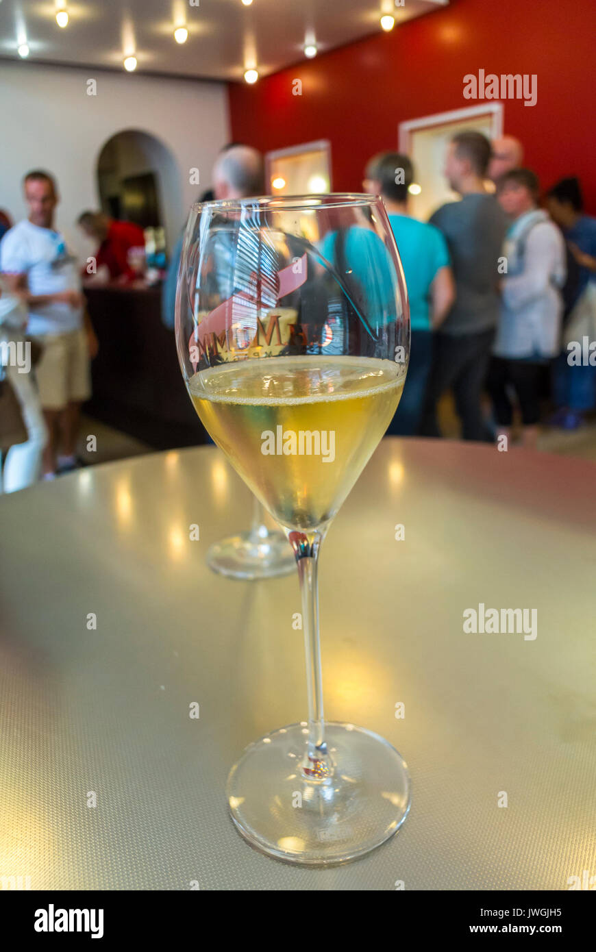 Reims, France, Tourists Visiting Mumm Champagne Cave, Glass of Champagne on Bar Detail - Stock Image