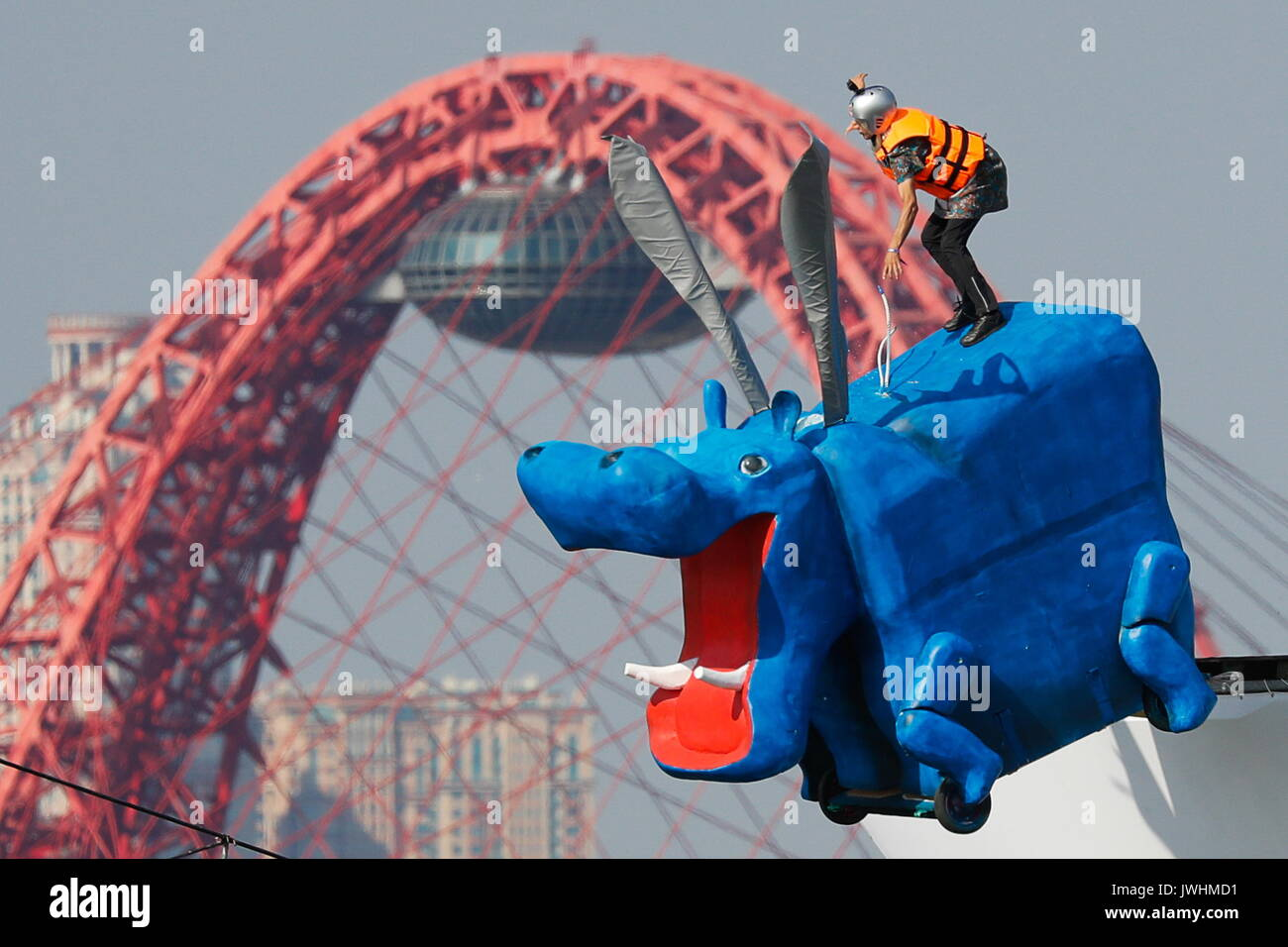 Moscow, Russia. 13th Aug, 2017. A participant jumps into the water in his homemade flying machine during the 2017 - Stock Image