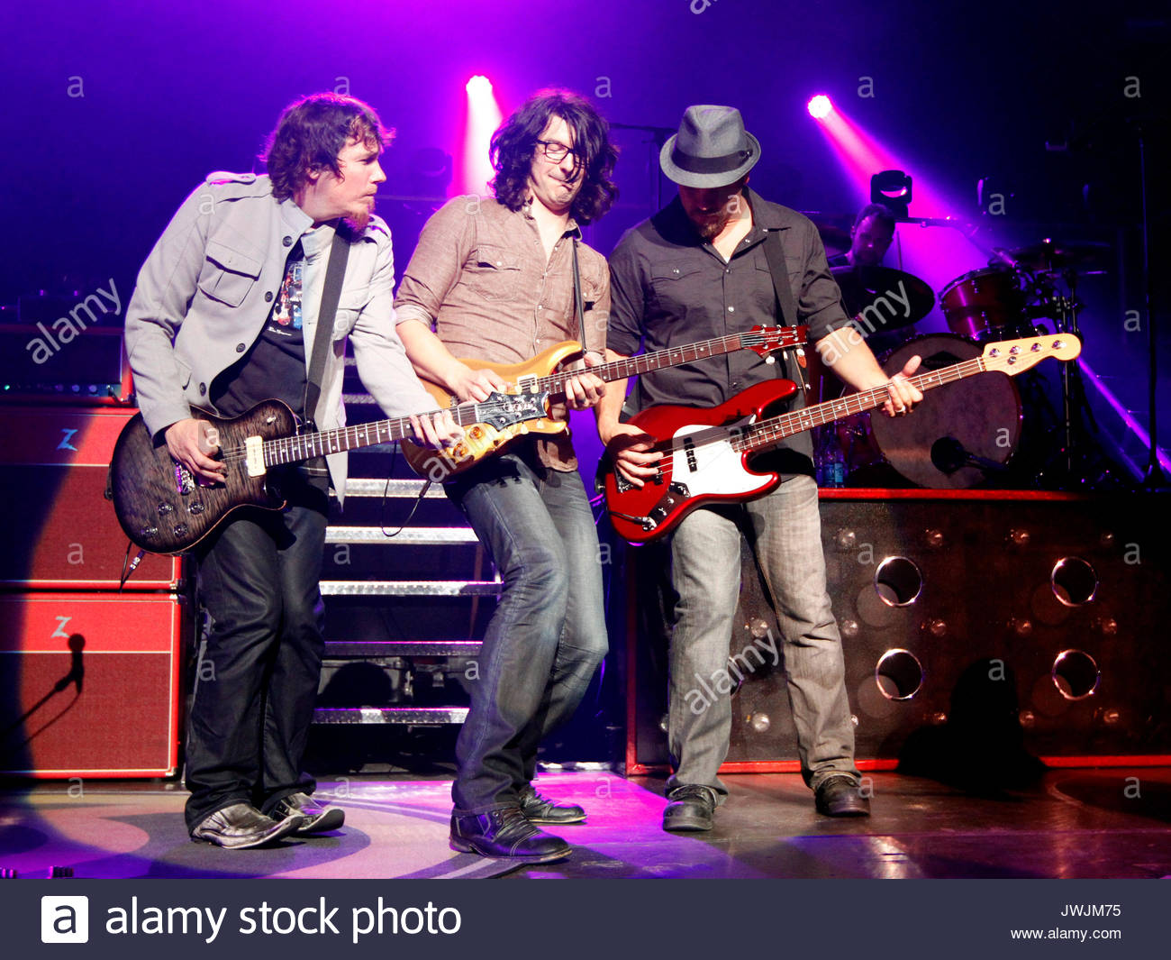 Mark David Lee, Jason Heard and Samuel Tai Anderson. Christian rock band Third Day made a stop on their Miracle - Stock Image