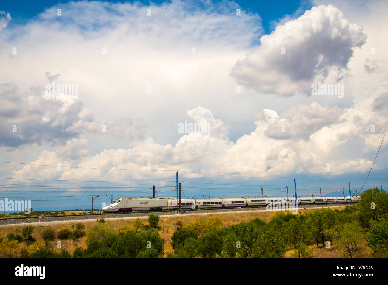 Alvia high-speed train traveling near Madrid. Fuencarral, Madrid, Spain. - Stock Image